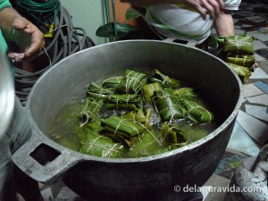 putting the tamales in the pot