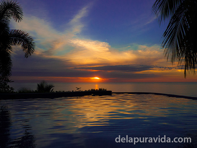 costa rica sunset and infinity pool