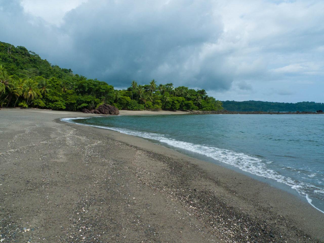 deserted beach made of seashells and rocks Osa Peninsula Costa Rica