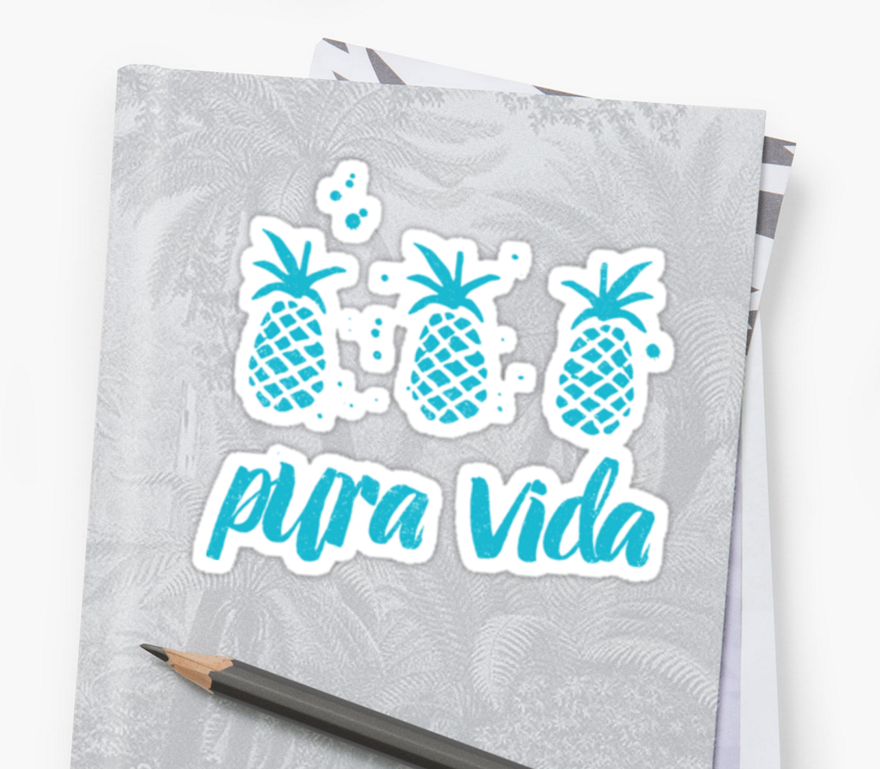 pura vida pineapples sticker on a notebook