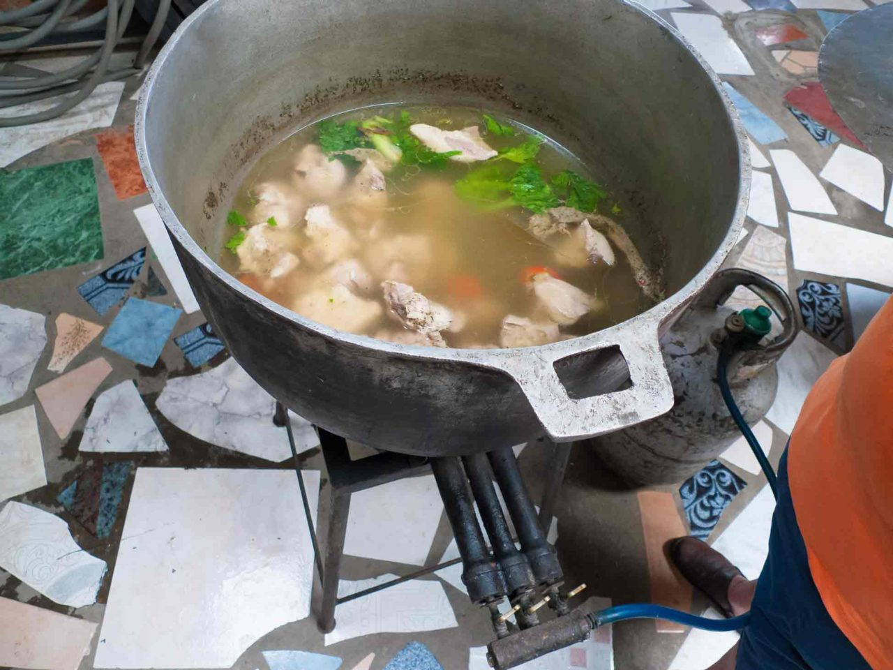 Costa Rican Tamales - cooking the pork and making the broth for the tamales. Recipe with photos