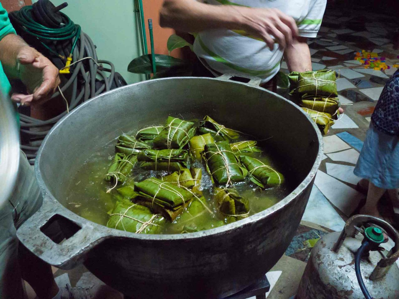 Costa Rican Tamales - throwing them in the pot! Recipe with photos