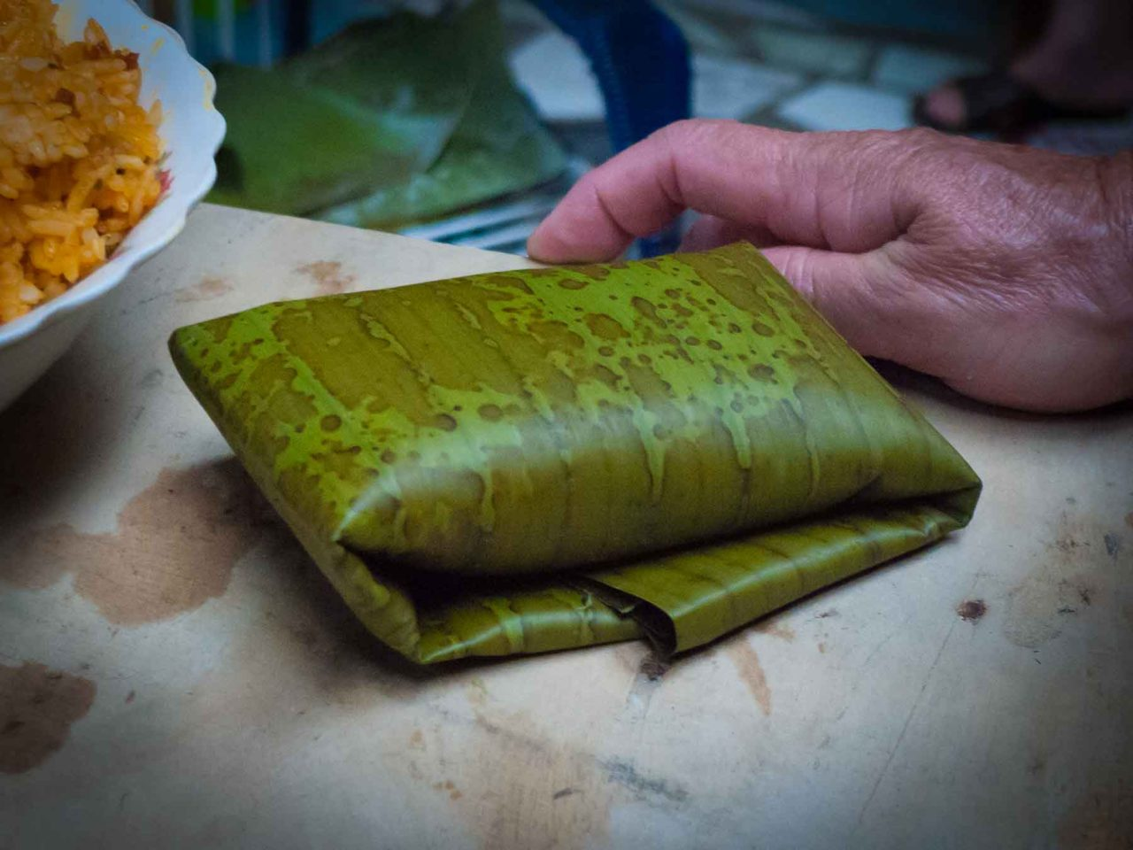 Costa Rican Tamales - folded in a plantain leaf. Recipe with photos