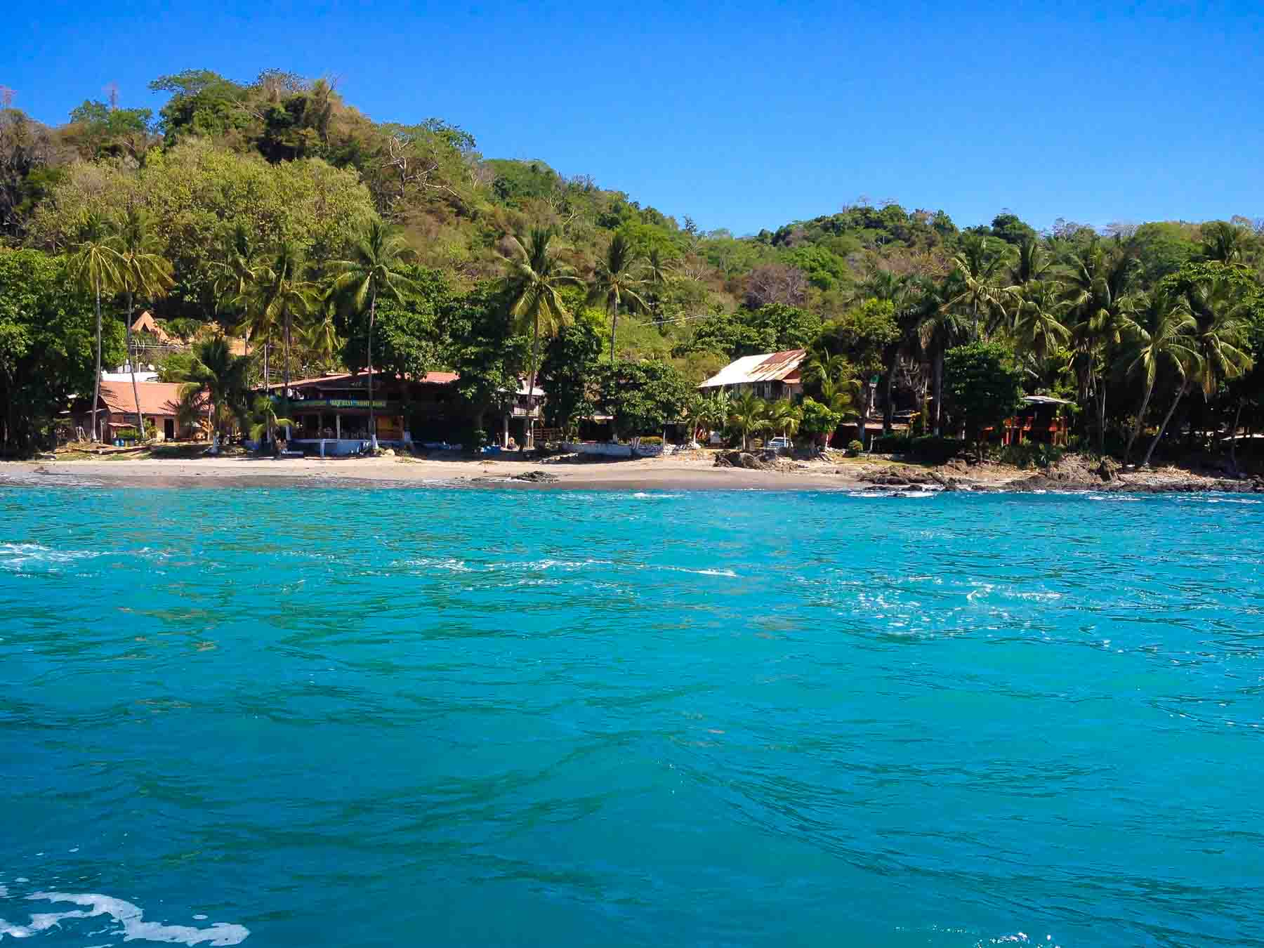 Small coastal town of montezuma costa rica seen from the water