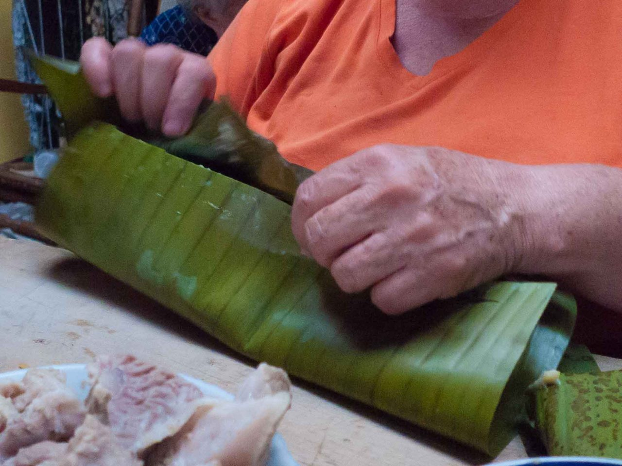 Costa Rican Tamales - double wrapping them in plantain leaves! Recipe with photos